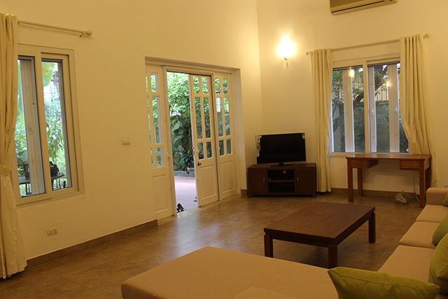 Beautiful private villa with 4 bedrooms, modern furniture, and big garden for rent in Nghi Tam village, Tay Ho district, Hanoi