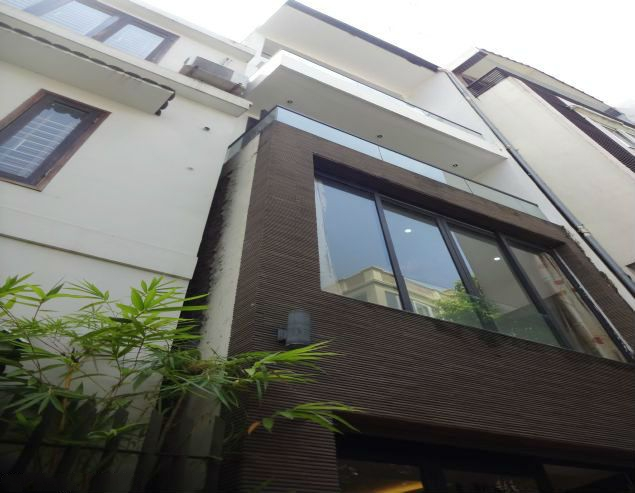 Partly furnished house with 4 bedrooms for rent in Dang Thai Mai, Tay Ho, Hanoi.