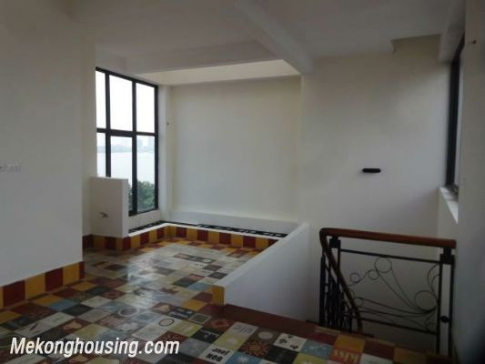 Partly furnished house with 4 bedrooms for rent in Dang Thai Mai, Tay Ho, Hanoi. 19