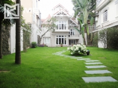 Very big yard villa with 4 bedrooms for rent in To Ngoc Van street, Tay Ho